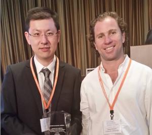 Ji Yan, left, with Eastern Economic Journal Associate Editor Diego Nocetti